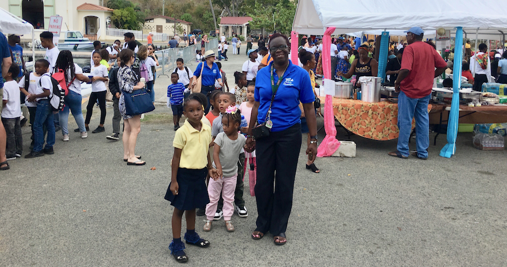 Sprauve School kindergarten teacher Lucille Parsons leads the littlest students back to school after a busy morning at the 2019 Folklife Festival. (Source file photo)