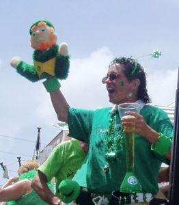 A leprechaun is waved to the Christiansted crowd during the 2008 St. Patrick's Day Parade. (File photo)