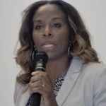 Stacey Plaskett addresses a town hall meeting Saturday at UVI on St. Croix.