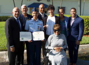 Lt. Ronaqua Russell surrounded by family, with her Air Medal. (U.S. Coast Guard photo)