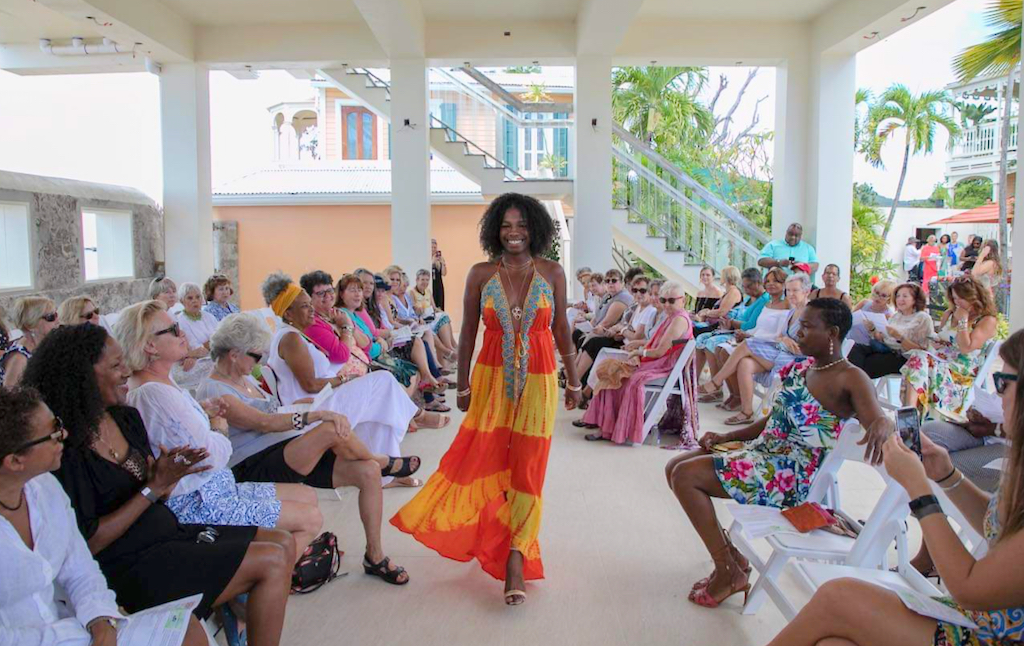Model Jai Issa, wearing a design from Envii Boutique, walks the runway at the third Crucian Fashion Fest Sunday in Frederiksted. (Photo by Kelly Greer Culp)