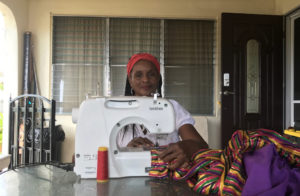 Curliss Solomon-John works at sewing machine, turning out the mocko jumbie costumes. (Elisa McKay photo)