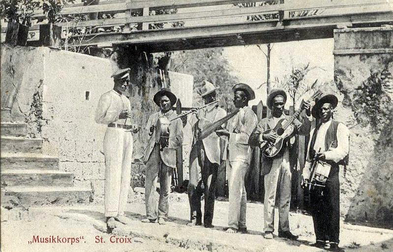 This St. Croix band during the Danish period has several elements of later quelbe or scratch music bands, including flute, such as Stanley Jacobs plays with the Sleepless Knights today; the gourd as a percussion instrument and guitar.