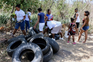 A dozen or more Crucians gather to collect trash on St. Croix this spring. (File photo by Linda Morland)