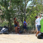 Melissa Ferreras adds more beach trash to the bin during Sunday's beach cleanup on St. Croix. Just Right Trucking and Trash Removal donated their services. (Linda Morland photo)