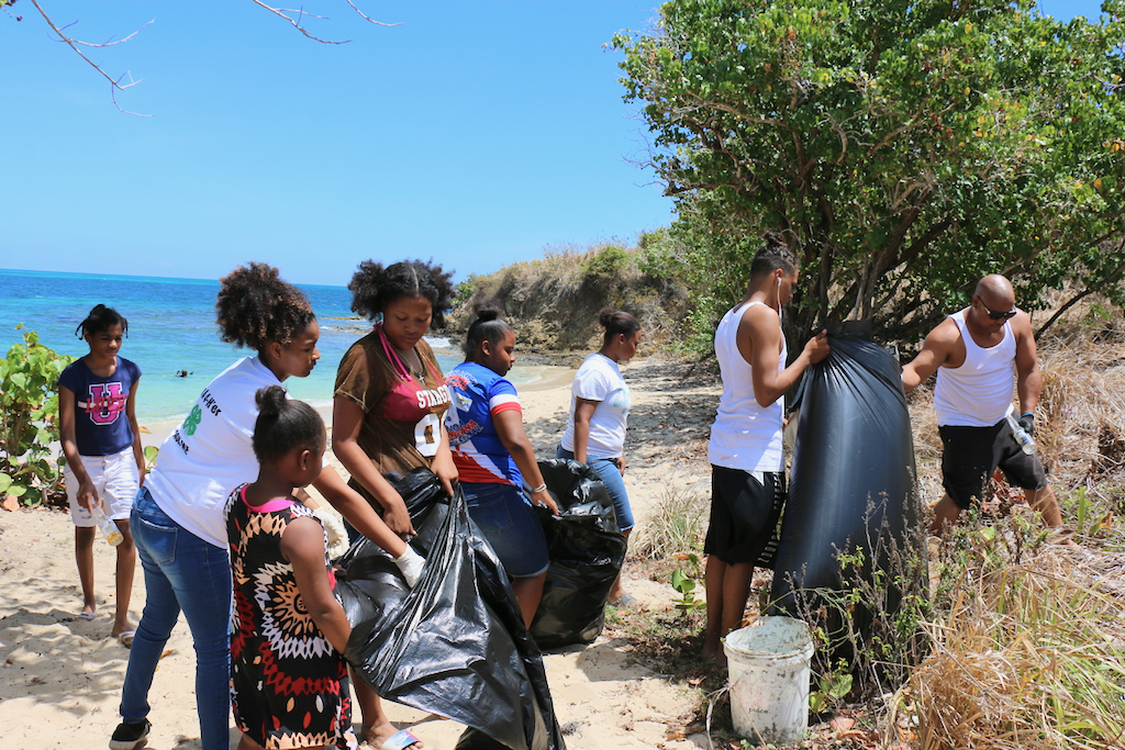 Some of the 12 to 14 people of all ages who worked together to gather and dispose of trash along the beach in preparation for the upcoming Easter camping. 4-H Ambassadors and Dominicans in Action Committee Members made up the volunteers. (Linda Morland photo)