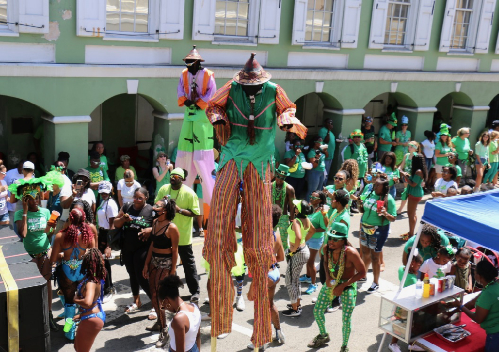 For a day, their green garb makes these moko jumbies the tallest leprechauns anyone's ever seen. (Linda Morland photo)