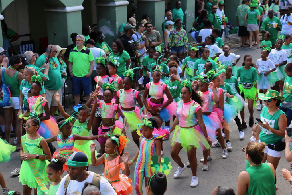 Students from Pearl B. Larsen Elementary School wore green – and almost every other color – as they danced through Christiansted Saturday. (Linda Morland photo)