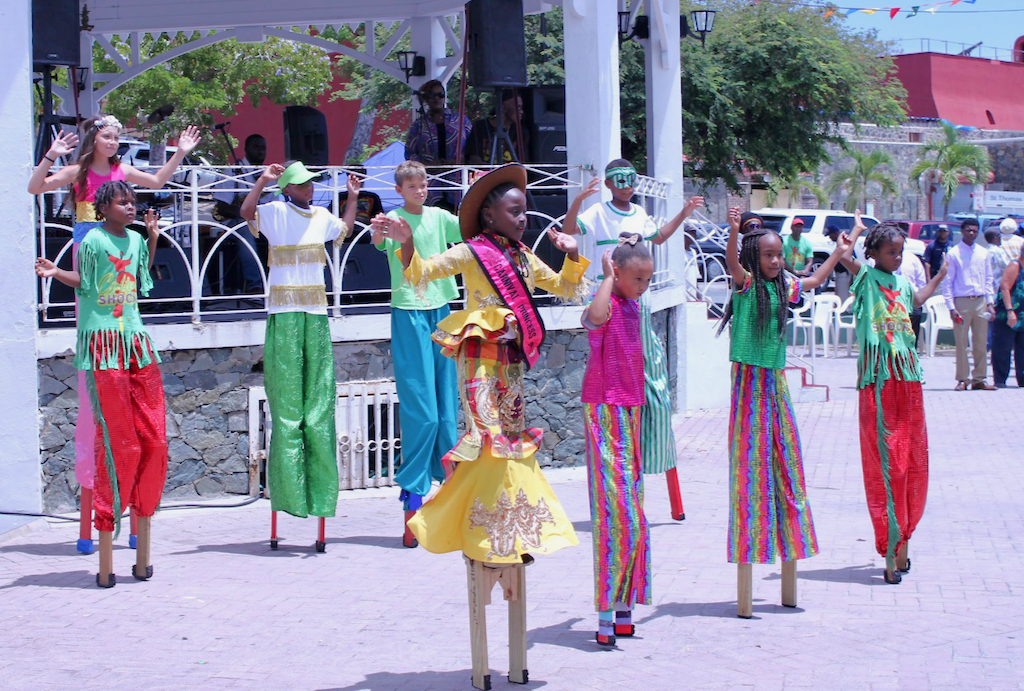 Culture Shock, a group of young moko jumbies, had nine performers in the Emancipation Garden wearing colorful outfits while boogeying on wooden stilts. (Bethaney Lee photo)