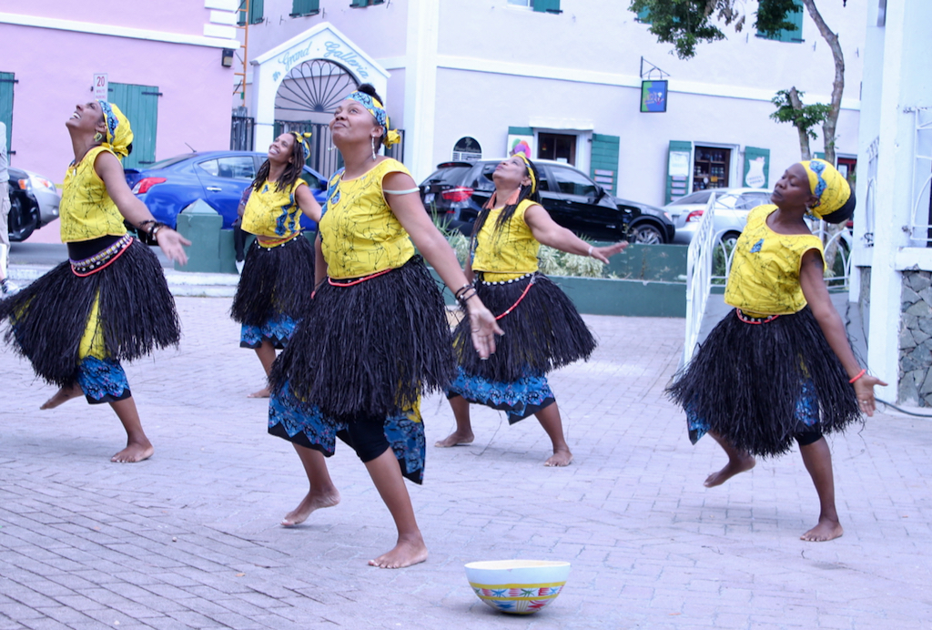Earth Mama's Pan African Dance Company perform while providing decorated bowls for attendees to leave donations instead of traditional money spraying, which is the act of sticking money to a performer's forehead. (Bethaney Lee photo)