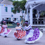 Members of the Macislyn Bamboula Dance Company swirl and twirl to entertain large groups of spectators. (Bethaney Lee photo)