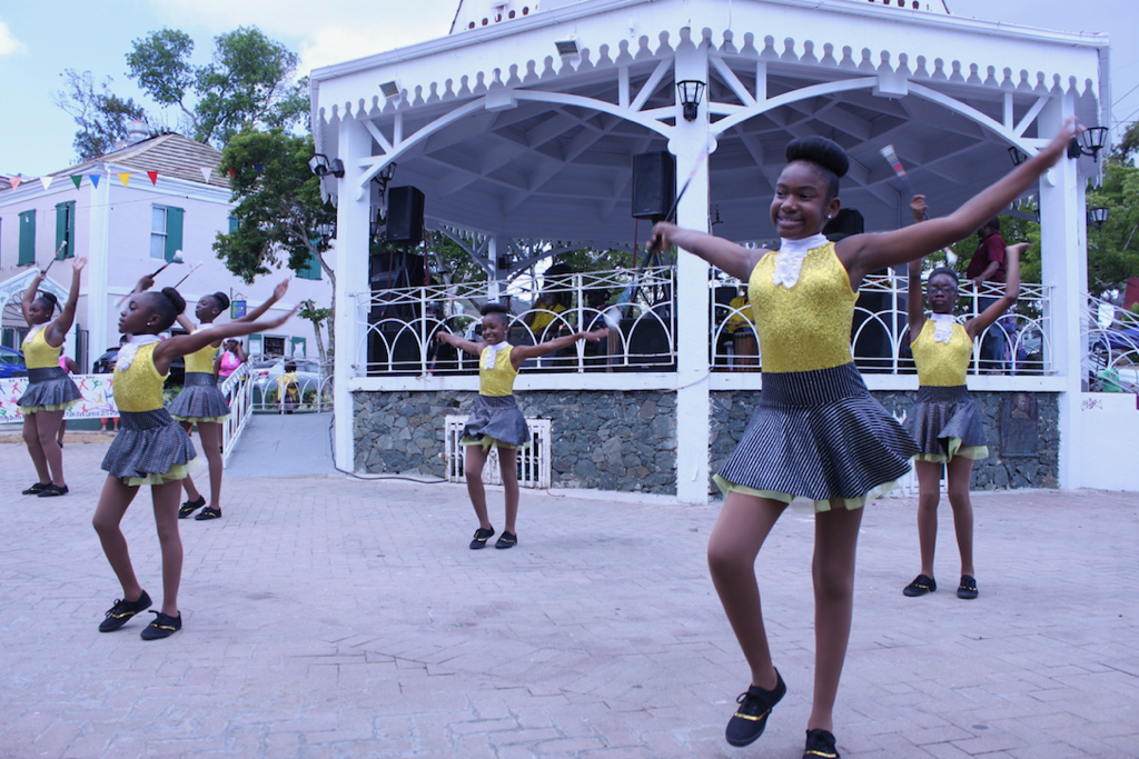 Intermediate skilled students of St. Thomas Majorettes, a nonprofit organization teaching students baton twirlingwho, sparkle in gold and black outfits while performing their routine. (Bethaney Lee photo)