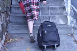 A girl heads home in her Joseph Sibilly Elementary School uniform skirt.
