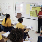 Shanice Wilson, a volunteers from Banco Popular, leads a Junior Achievement discussion at Elena Christian Junior High School on St. Croix. (Photo provided by Denelle G. Baptiste)