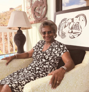 Theodora Tuts Moorehead and one of her abstract drawings. (Photo by David Knight)