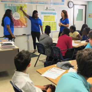 Volunteers Sherry-Ann Francis, Shena Esannason, and Alice Krall talk to Gift Hill School students about careers. (Amy Roberts photo)
