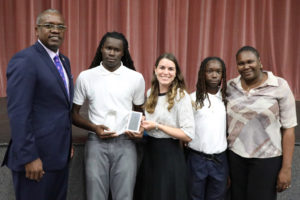 From left, Gov. Albert Bryan poses for a photo with Saeed Phillips, AT&T representative Alexandria Veridailes, Phillips' brother Khaled Heywood and his mother Estica Ceasar. (Government House photo)