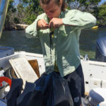 A volunteer bundles plastic trash from St. Thomas's mangroves. (April Knight photo)