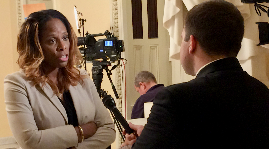 Stacey Plaskett talks to a TV reporter after leaving the House floor, where discussion on the Violence Against Women Act was going on. The measure passed with Plaskett's amendment increasing the funds allocated to the territories. (Don Buchanan photo)