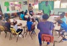 Field technician Ellisha Williams, Principal Rosemond Lawrence-Creighton and teacher Petra Wilson work with St. Croix with students at S. Croix Christian Academy.