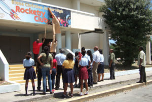 The rocketry club from Elena Christian watches a banner being hung at the school before it closed in 2015. (File photo by Susan Ellis)