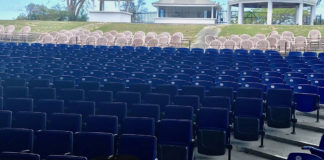 Island Center seating. In the rear, from left are the food concession, drink concession and ticket office, and the gazebo entry way. (Eliza McKay photo)