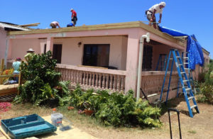 Lutheran Disaster Response volunteers work on Grimilda Quinones house in Frederiksted.