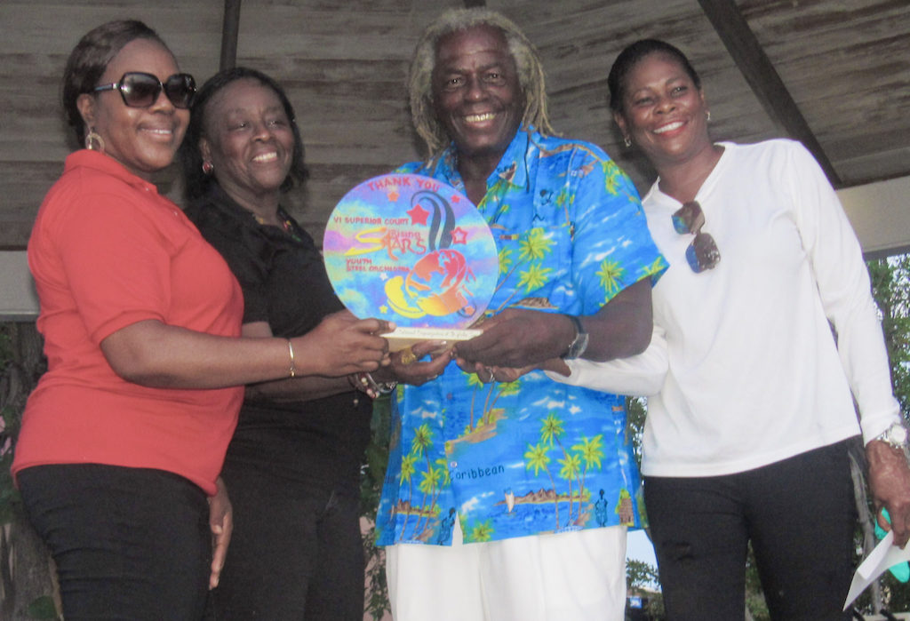 "St. Croix Rising Stars Youth Steel Orchestra director Natasha Williams-Modeste presents an appreciation award to St. John Festival Committee members Alecia Wells, Liston ""Matey"" Sewer, and Leona Smith"