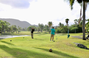 Playing the course on a lovely afternoon, two players watch as one of their drives soars towards the green. (Linda Morland photo)