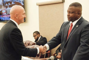 VITEMA Director Daryl Jaschen, left, shakes hands with Sen. Athneil Thomas after his senate confirmation Tuesday. (Photo by Barry Leerdam for the V.I. Legislature)