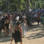 Event goers roam Magens Bay as they sample a variety of wings.