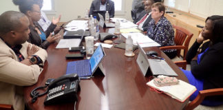 Discussing disaster recovery at the PFA board meeting are Kirk Callwood, Jenifer O'Neal, Keith O'Neale, Gov. Albert Bryan, Nathan Simmonds, Dorothy Isaac and Adrienne Williams-Ocatalien.