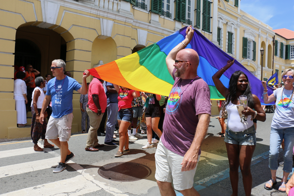 The 2019 St. Croix Pride Parade finished with a large rainbow banner proudly displayed by multiple participants. (Linda Morland photo)