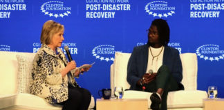 Former Secretary of State Hillary Rodham Clinton speaks with St. John artist Kurt Marsh, Jr. about preserving arts and culture post-hurricanes.