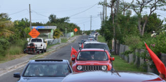 More than 100 people take part Saturday in the Caravan Red Flag on St. Croix.
