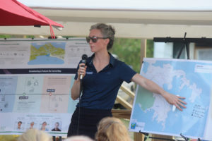 Becky Tharp, water quality program manager for Watershed Consulting Associates, addresses Tuesday's crowd.