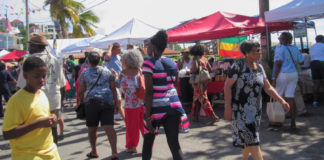 Visitors peruse the goods at the 2019 St. John Festival Food Fair. (Source photo by Raven Phillips)
