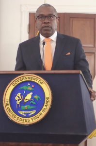 Gov. Albert Bryan addresses a news conference Tuesday. (Source photo by Susan Ellis)