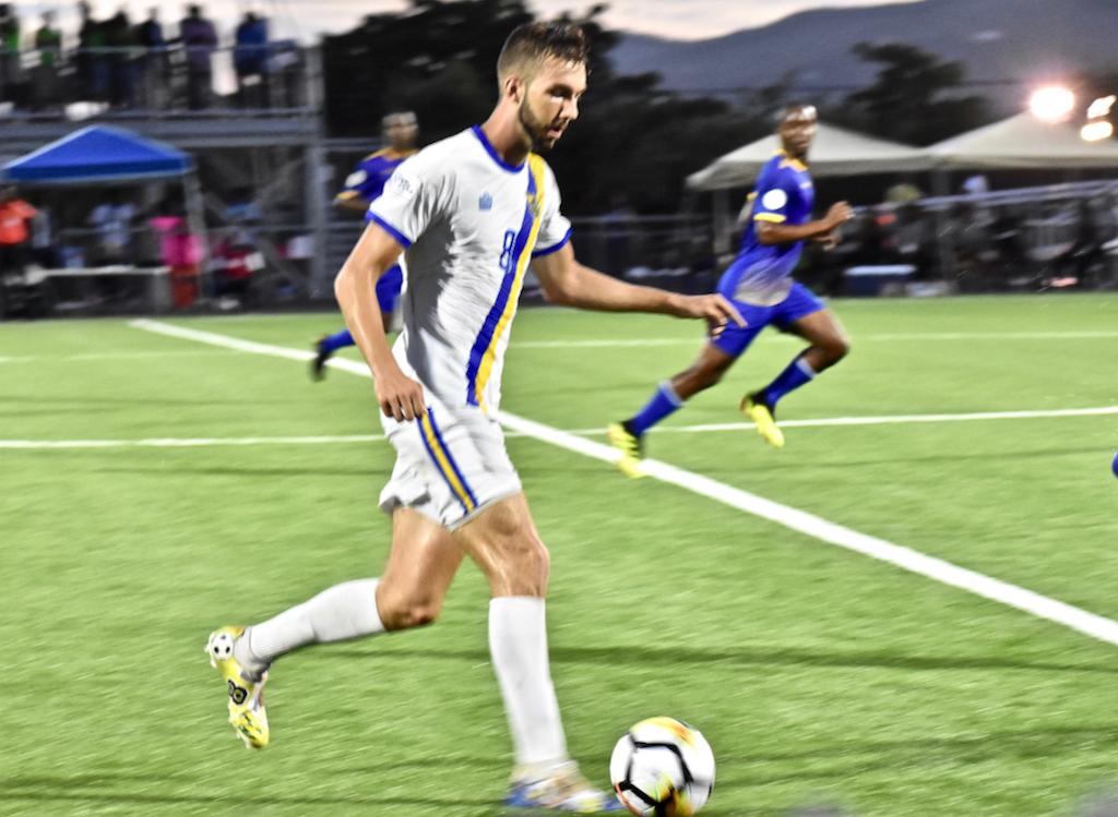 Jett Blaschka of the USVI drives the ball upfield against Barbados Sunday. (Source photo by Wyndi Ambrose)