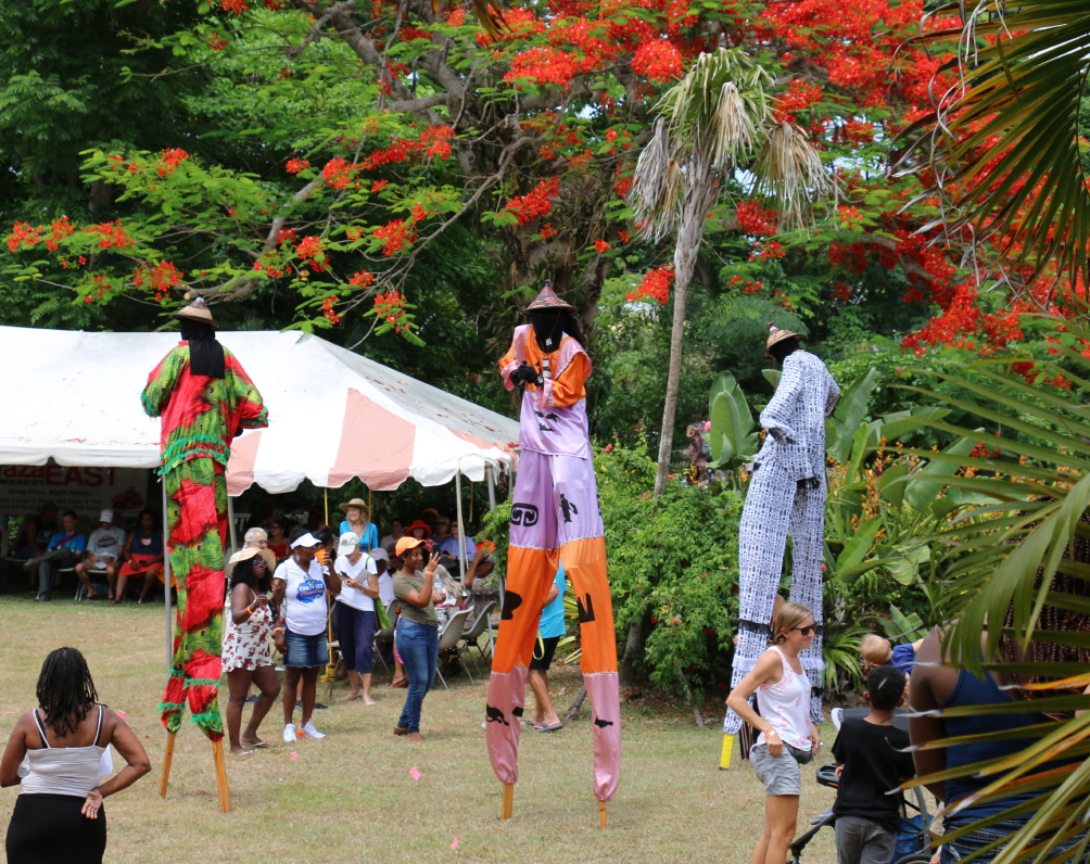 There was color everywhere as the Guardians of Culture Moko Jumbies entertained. (Source photo by Linda Morland)