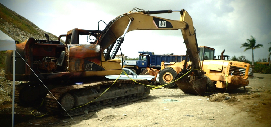 This excavator is among the equipment destroyed by fire at the landfill June 17. (Source photo by Susan Ellis)