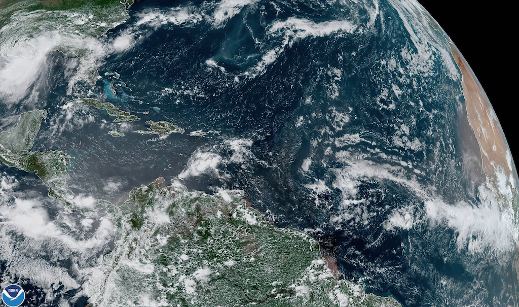 Satellite photo shows a tropical wave, roughly a third of the way to the right, midway between the Cabo Verde Islands and the Windward Islands. (NOAA photo)