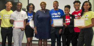 Winning Junior Achievement company Local Promoters and JA executive director Denelle Baptiste. (Source photo by Raven Phillips)