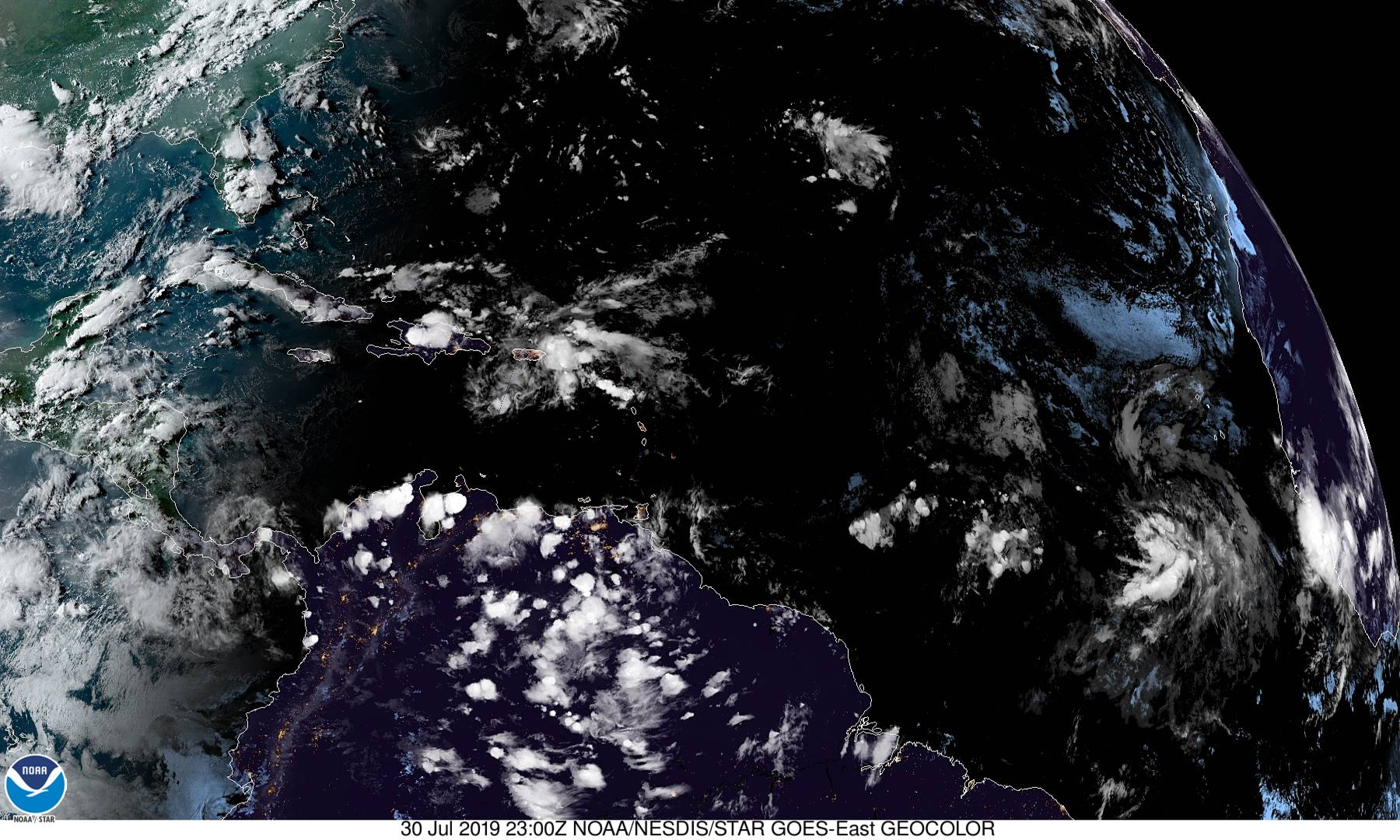 Satellite photo shows the tropical wave crossing through the Caribbean, left, and the new system forming in the eastern Atlantic.