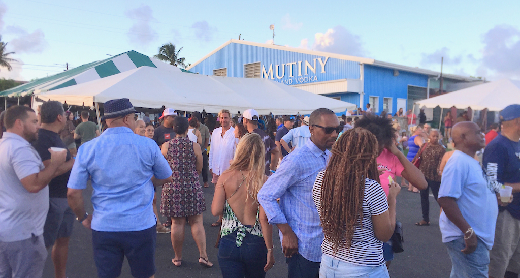 The crowd enjoys the food, music and more at Saturday's grand opening of the Mutiny distillery. (Source photo by Susan Ellis)