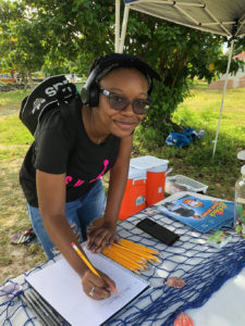 Jada Roberts, a junior at UVI, is the first of 185 volunteers to show up for the premier 2019 Coast Weeks clean-up on St. Thomas. (Source photo by Teddi Davis)