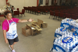 Paradise Covenant Ministries relief drive volunteer Jacqueline Clendinen shows off some of the donated items received Saturday for victims of Hurricane Dorian in the Bahamas. (Source photo by Judi Shimel)