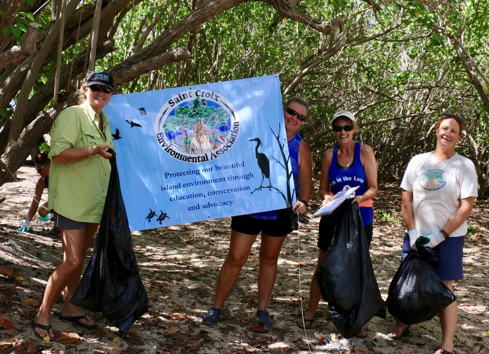 Clean up of the Southgate beach was sponsored by The Saint Croix Environmental Association. From left: Kristin Hobson, Felicia Myers, Ellen Ross and Jen Valiulis. (Source Photo by Linda Morland)