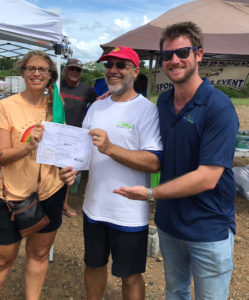Gaylin Vogel, left celebrates winning first place Saturday with Rob Upson the local organizer for National Drive Electric Week, and Drive Green V.I. managing partner Adrien Austin. (Photo by Corinne van Rensselaer)