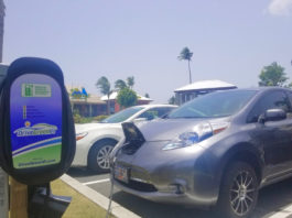 A Nissan Leaf at a charging station enjoys free power beachfront at Margaritaville. (Photo provided by St. Thomas Drive Electric day organizers)